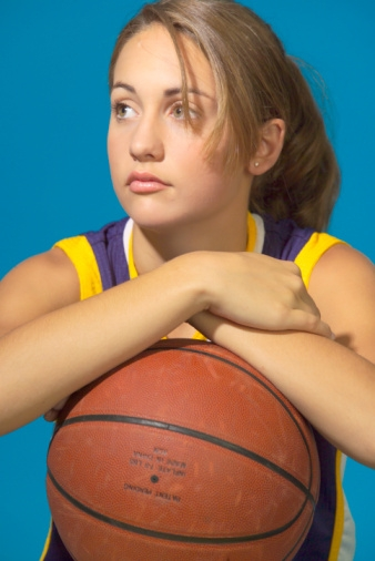Young female with basketball